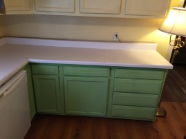 green cabinets, white counter
