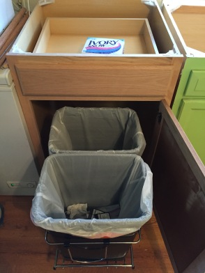 the new cabinet with garbage and recycling containers